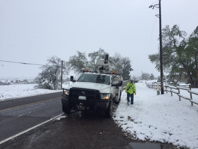 Snowy Road and Lineman with Truck