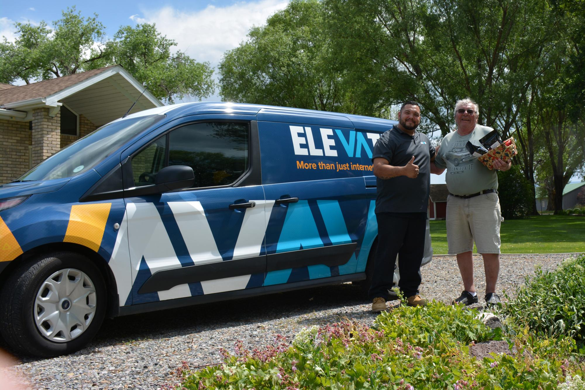 Elevate Fiber install specialist, Ray Saenz, with Elevate's 1,000th connected customer, Larry Foltz, in zone Montrose 721.