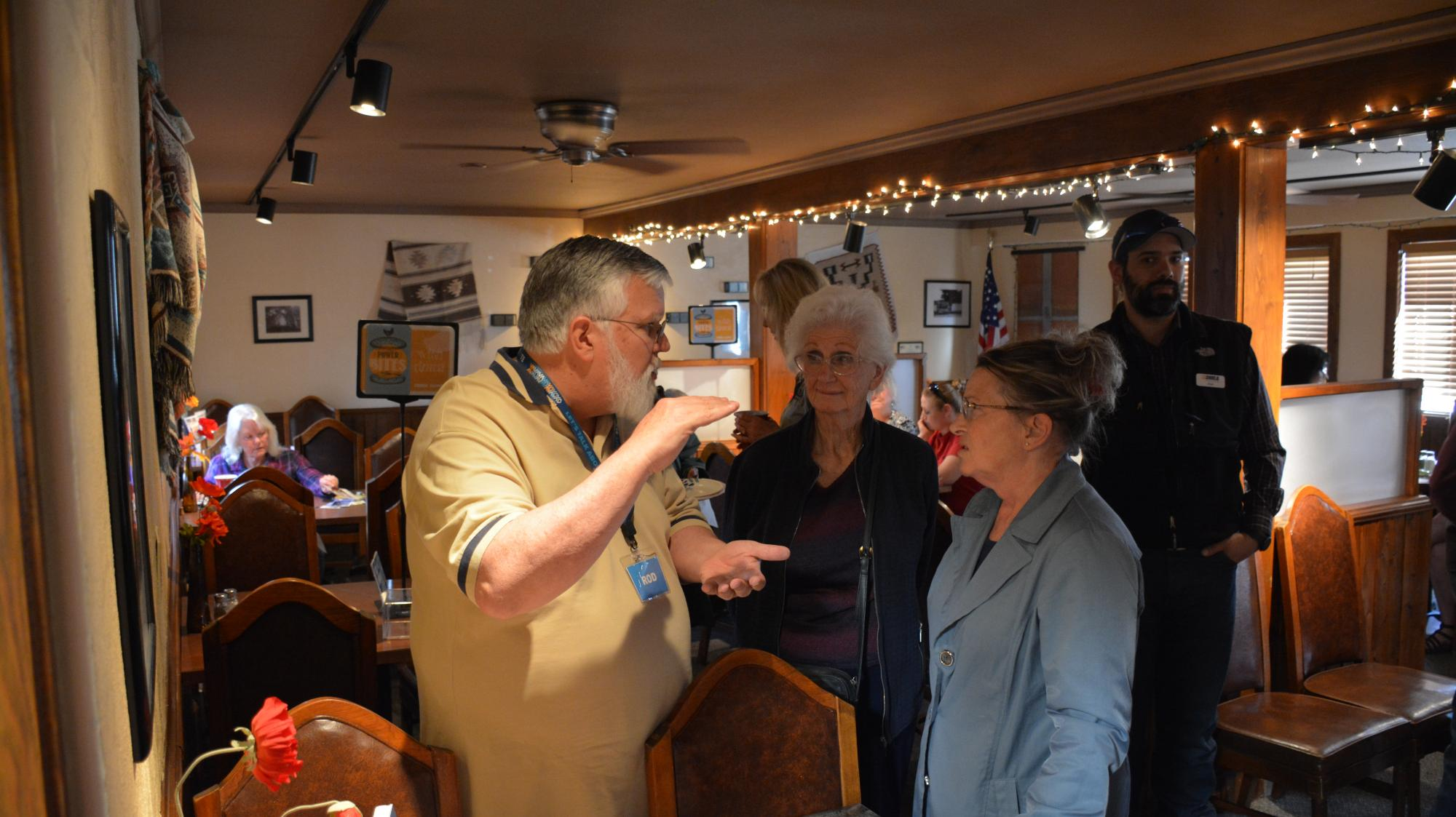 DMEA employees and board members talk with members during the Morning Buzz last year at the Looney Bean.